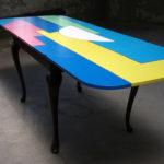 <p><strong>Beschichtung: 7-farbig lackiert, mehrfach Klarlacküberzug halbmatt<br /> </strong>Alessandro Mendini, Tisch, 2011<strong><br /> </strong></p>