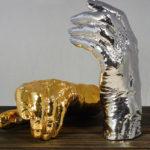 <p><strong>Luigi Colani, Epoxy-Gießteile, Chrom-Optik-Beschichtung, gold lasiert</strong></p>