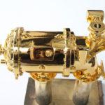 <p><strong>Lasersinter-Bauteil, Chrom-Optik-Beschichtung, gold lasiert</strong></p>