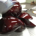 <p><strong>Ulrike Buhl, sculpture, real carbon, tinted red, sealed with clear coat, mirror polished</strong></p>