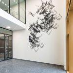 <p><strong>Coating: 2-coloured paint black/white, clear coat seal matt</strong><br /> Dorthe Goden, laser cuts from 2 mm sheet steel, Kunst am Bau, Justice Center Bad Kreuznach, EG / 1. OG, 2017<br /> Photo by: Thorsten Arendt</p>