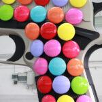 <p><strong>Beschichtung: Nickel-Optik, Soft-Touch-Lackierung schwarz, Smarties mehrfarbig lackiert</strong><br /> Kata Legrady, Colt, 2013, 450x290x65 cm<strong><br /> </strong></p>